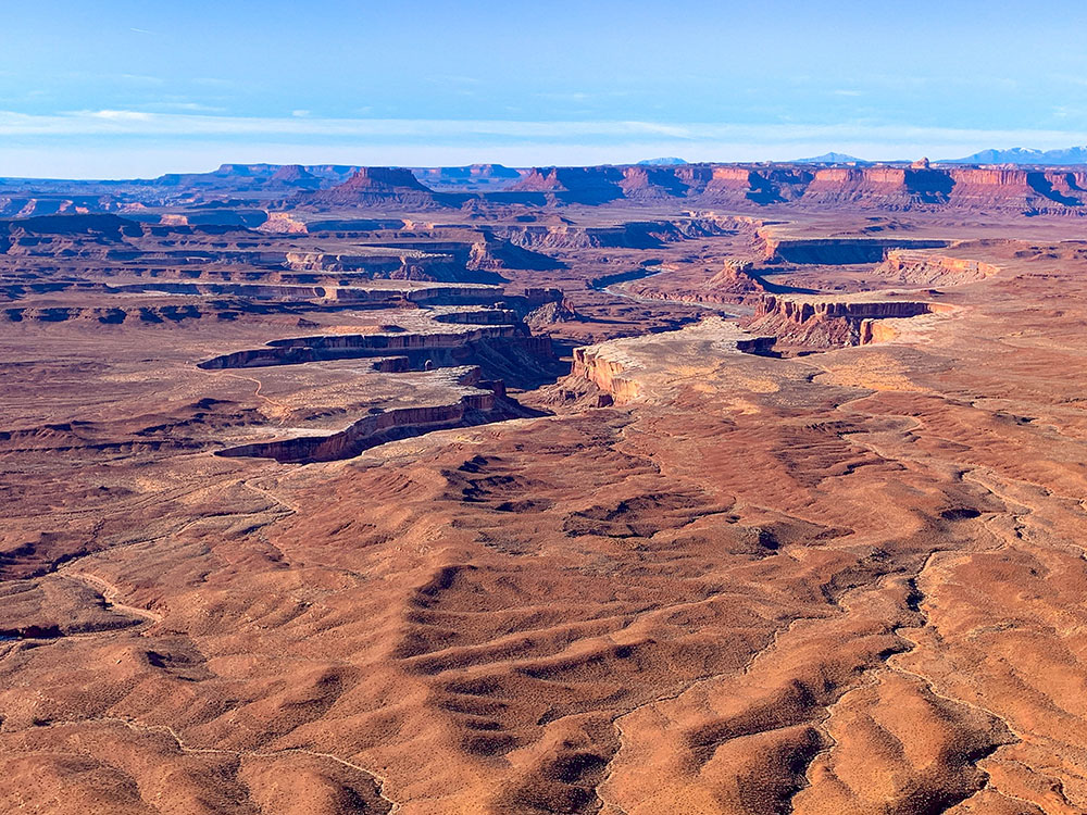 Overlooking the red rock landscapes with views of the Colorado River and La Sal Mountains
