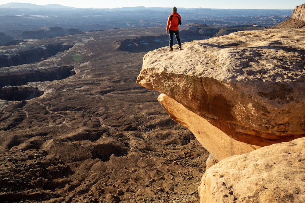Hiker looking out at Island in the Sky, Canyonlands national park.