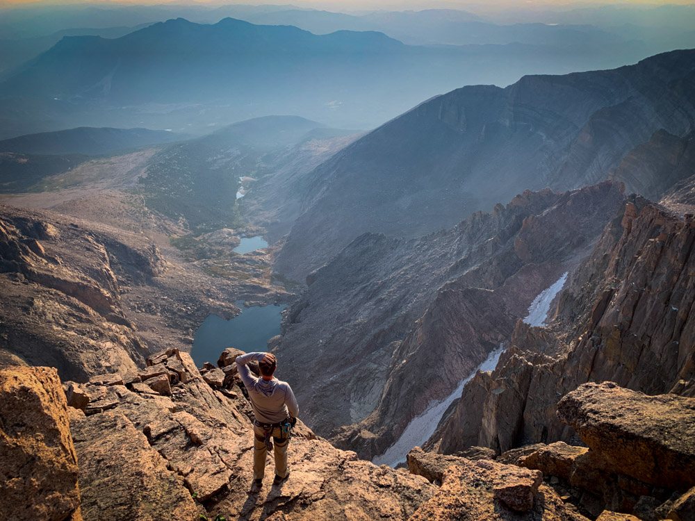 A hiker admiring the views of Rocky Mountain National Park.
