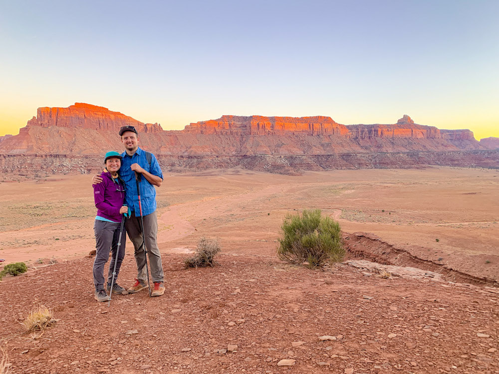 Two hikers posing for a photo in the Needles, Canyonlands National Park.