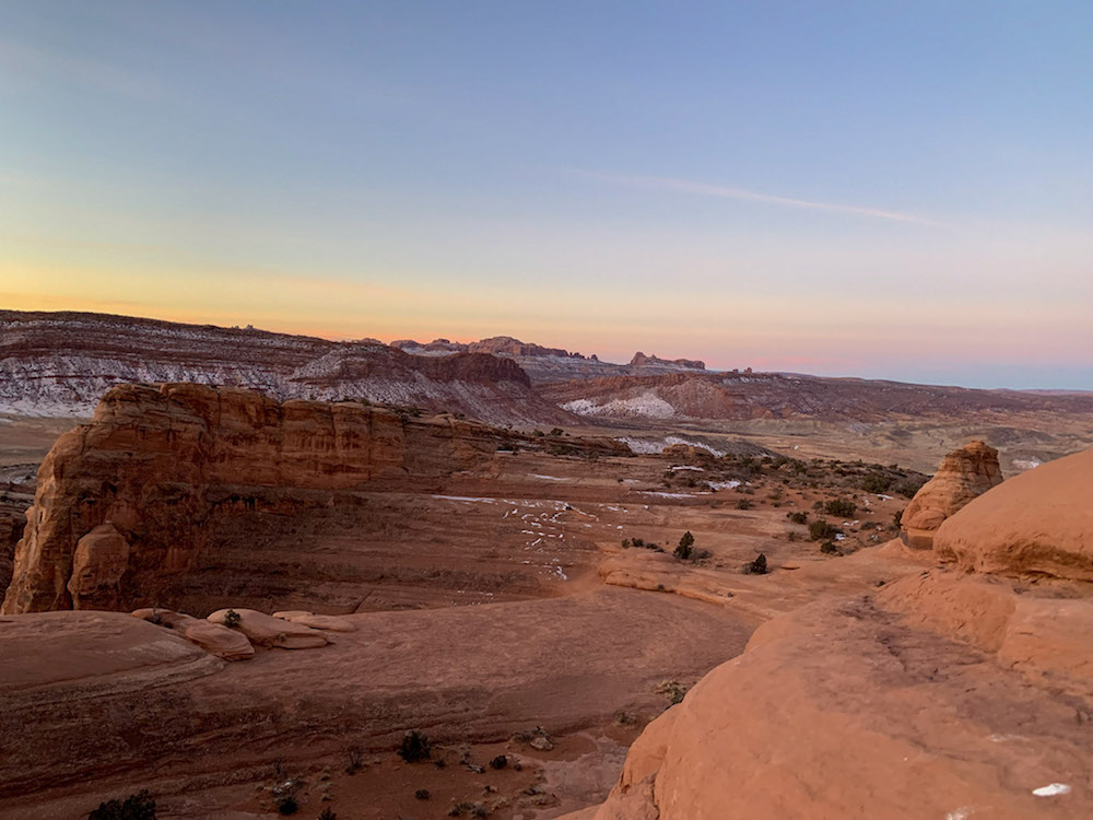 See the sunrise during your Arches National  Park itinerary.